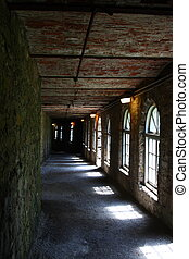 passageway - corridor or passageway hall lit by arched...