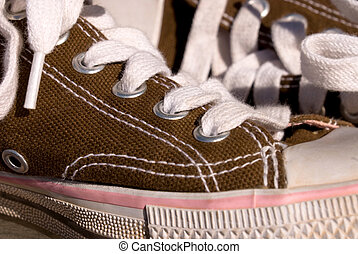 Tennis shoes - A close up image of canvas tennis shoes shows...