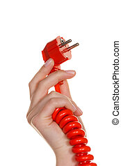 Power cord into a womans hand - A womans hand holding a red...