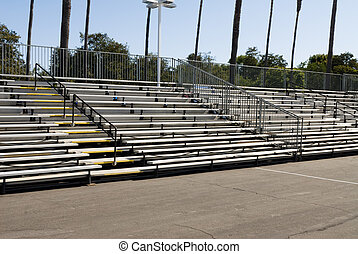 Empty bleachers during daytime - Empty bleachers during the...