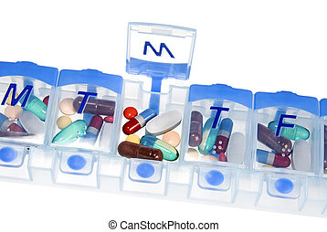 Pill box for medication - An isolated pill box used to store...