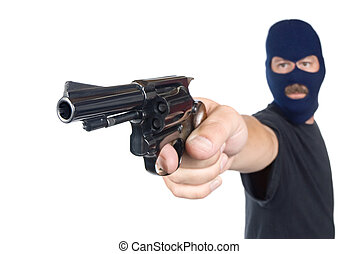 Armed robber - A robber with hidden face points his gun in a...