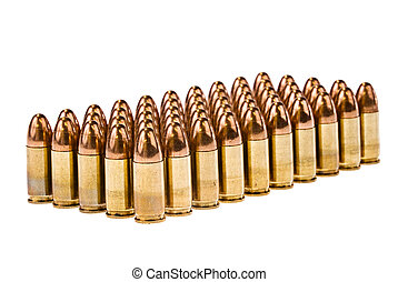 Rows of bullets - Rows of 45 caliber bullets isolated on a...