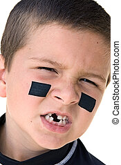 Young hockey player snarling - A young boy getting reaqdy to...