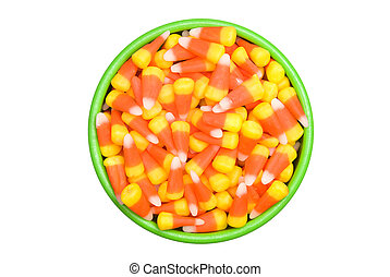 Candy Corn in Bowl - A bowl of candy corn isolated on a...