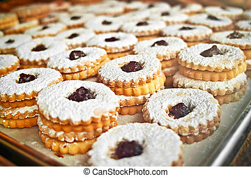 Cookies on baking tray - Jam sandwich cookies stacked on a...