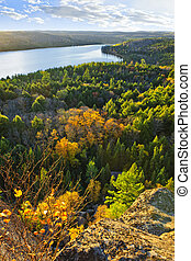 Fall forest and lake top view - Lake and fall forest with...