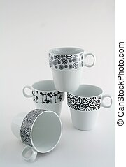 Black and White Coffee Mugs - Four black and white coffee...