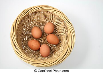 Eggs in a Basket - Five brown hen eggs in light brown wicker...
