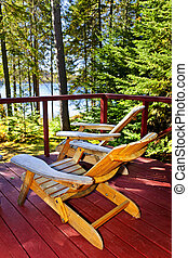 Forest cottage deck and chairs - Wooden deck at forest...