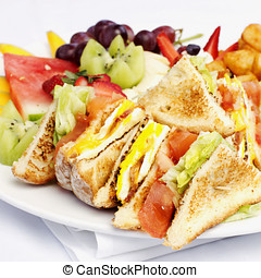 Breakfast club sandwich and assorted fruits