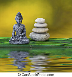 Buddha and stone stack - Buddha statue and pebble cairn