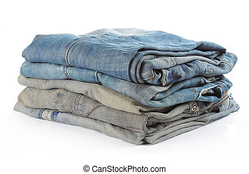 stack of five various shades of blue jeans