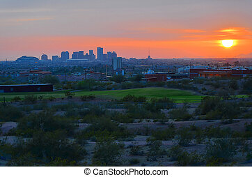 Sun dipping over Phoenix - sunset over downtown Phoenix,...