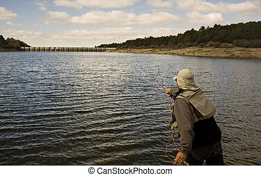 fly fishing in a lake of Segovia, Spain.