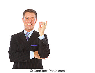 Attractive business man pointing at copy space