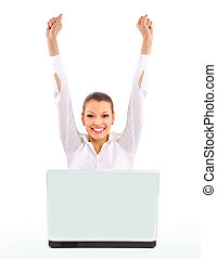 business woman with her hands raised while working on laptop