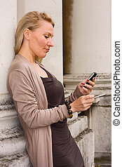 woman holding mobile phone and smoking