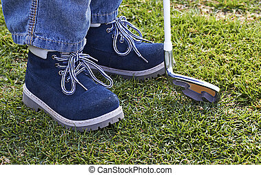 boy shoes and golf club on grass - leather shoes of a small...