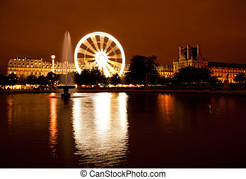 Night shot of Ferris wheel in Tuileries park in Paris,...