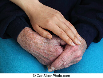 Young holding senior's hands - Senior and young women's...