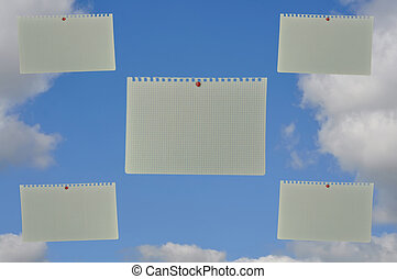 notebook paper with blue skies,
