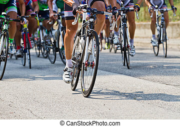cycling - The cyclists riding by at the bicycle race