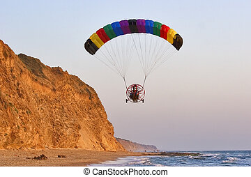 The parachuter decreases - Flight on an operated parachute...