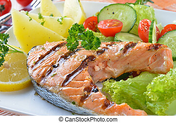 Salmon steak - Grilled salmon steak with potatoes and salad