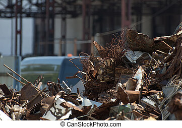 Pile of scrap iron and crane