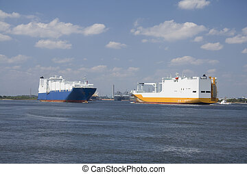 passing container ships - two large container ships pass...