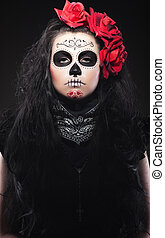 woman with roses dressed up for All Souls Day - Serious...