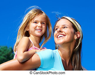 Happy family. Smiling young mother and daughter.