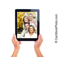 Tablet computer. - Photo of happy family on tablet computer....