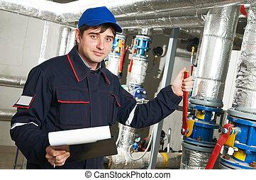heating engineer repairman in boiler room - maintenance...