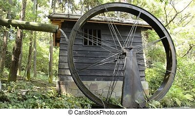 Water mill - Small Japanese water mill running in the Expo...