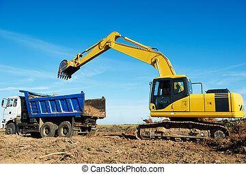 excavator loader at work - Heavy excavator loader at soil...