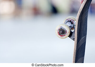 Skate wheel - a young man skating in a competition