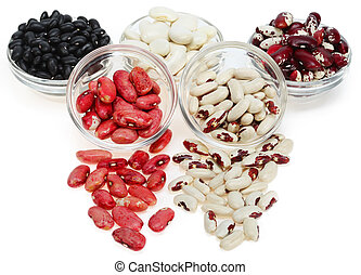 different varieties of beans in a clear glass bowl on a...