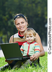 Smiling pregnant woman with laptop