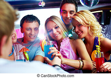 Party moment - Photo of pretty girls looking at barman with...