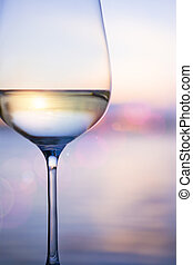 Art white wine on the sky background with clouds - white...