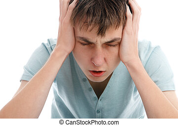 Headache migrain pain angst or stress - A teen boy showing...