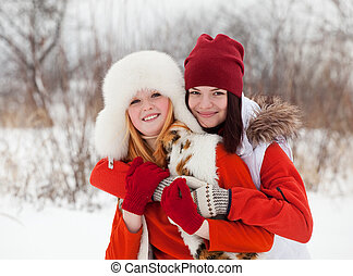 two smiling girls in winter