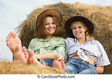country girls on hay - Portrait of country girls on hay in...