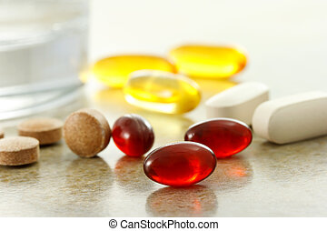 Supplement capsules and glass of water