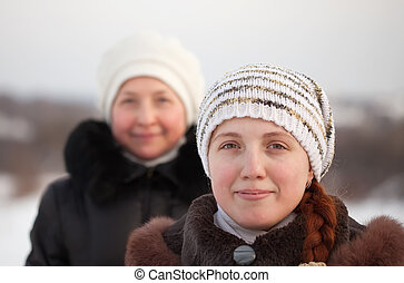 women in winte - Portrait of two women in winter park