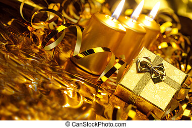 Gold christmas candles and gold gift boxes - Christmas...