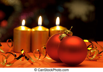 Christmas candles and red spheres A celebratory composition
