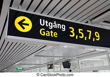 Departure gates - Typical illuminated directions sign in a...